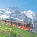 JUNGFRAUBAHN - Die Jungfraubahn vor der Jungfrau.  JUNGFRAU RAILWAY - The Jungfrau Railway and the Jungfrau peak.  Copyright by Jungfrau Railways     By-line swiss-image.ch