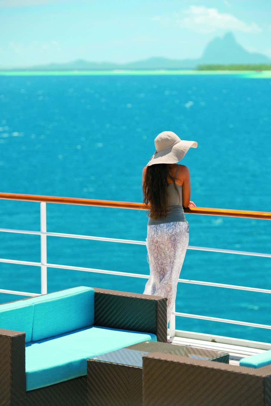The pool deck aboard the m/s Paul Gauguin offers sweeping views, ample seating and a pool bar.