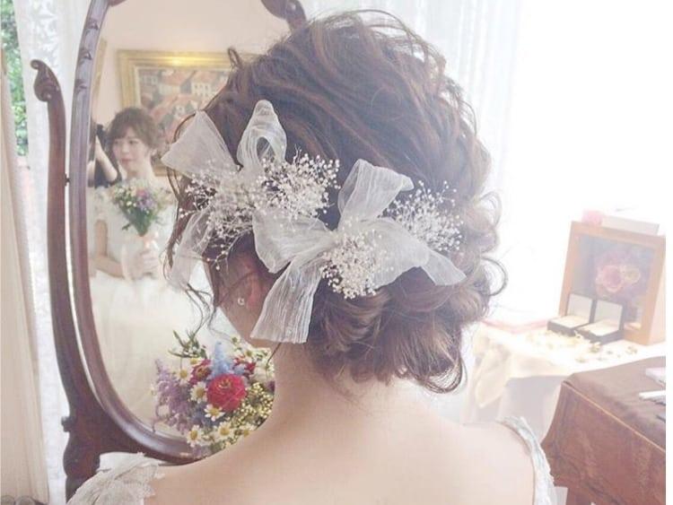 大人可愛い♡《シニヨン》の花嫁アレンジ10選*のカバー写真